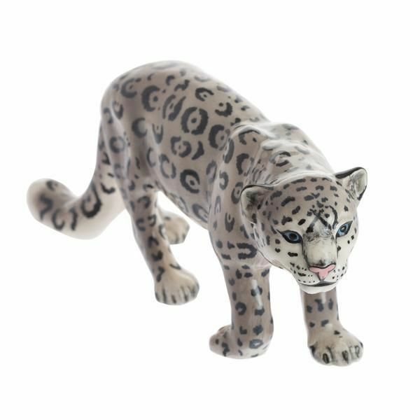 A ceramic, hand painted model of a snow leaopard.